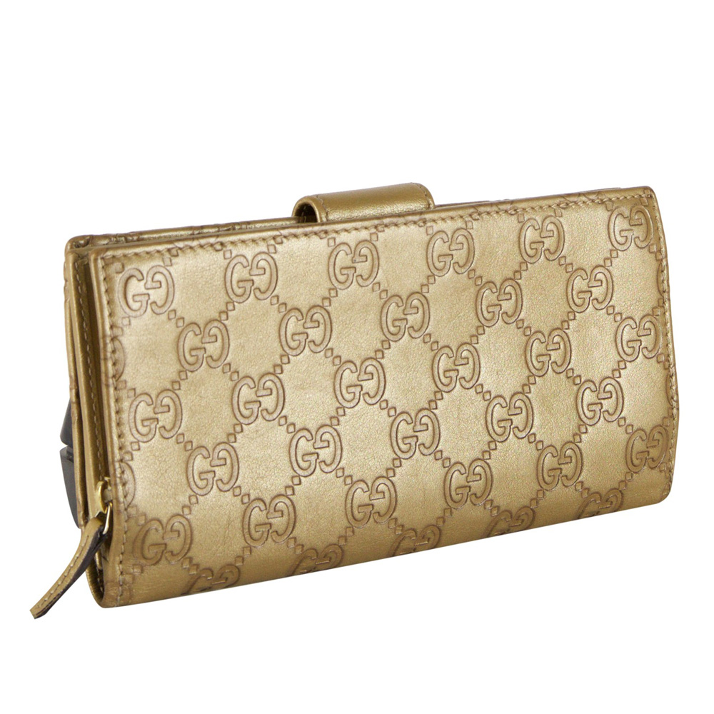 a0b8807bd260 GUCCI GUCCISSIMA GOLD LEAHTER D RING WALLET -